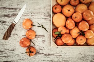 Tangerines on a weathered board