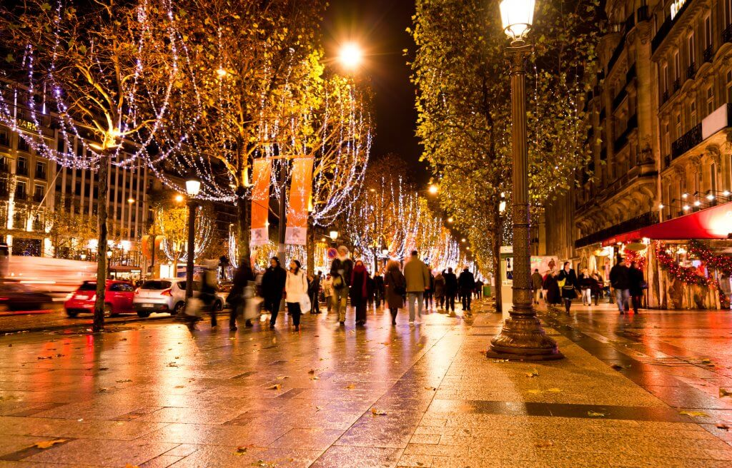 the famous shopping district Champs Elysees illuminated with Christmas lights in Paris in winter