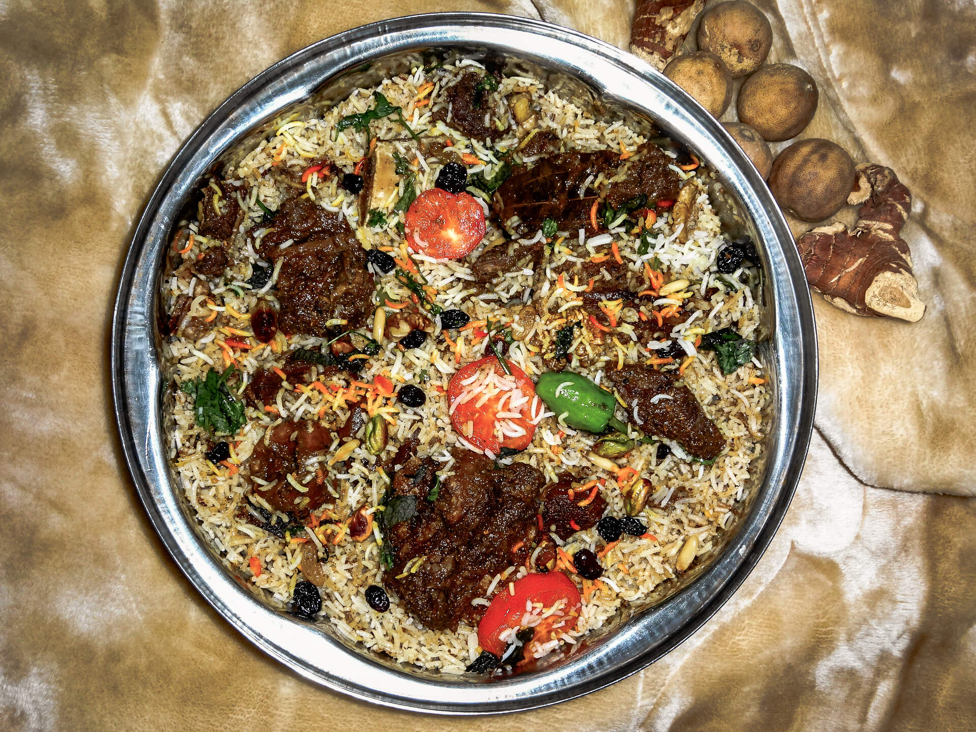 Popular Middle Eastern Foods: overhead photo of camel meat biryani in a dish
