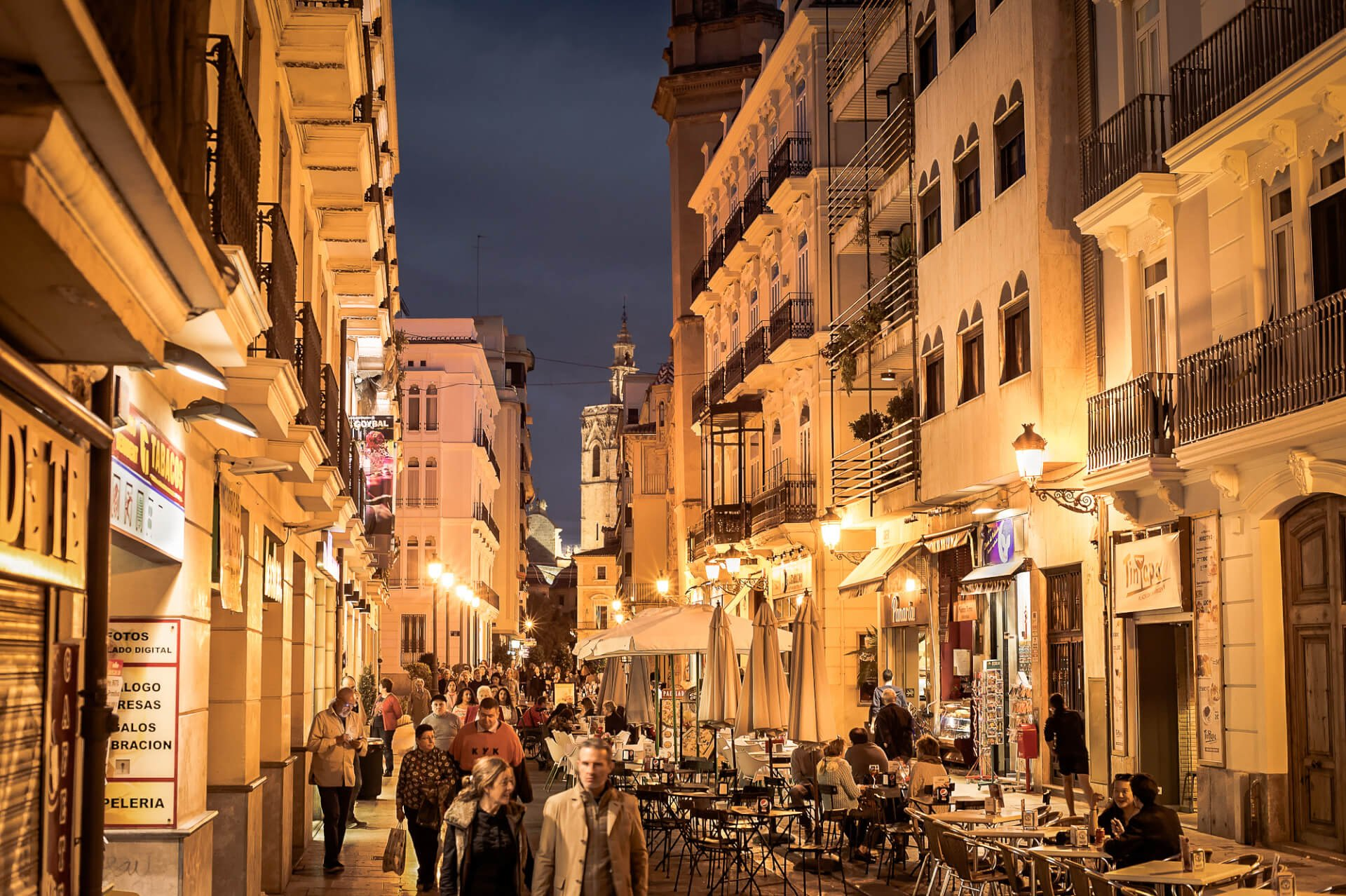 VALENCIA, SPAIN - NOVEMBER 06, 2106: People walking on Old Town street of Valencia. Valencia is the 3rd largest city in Spain.